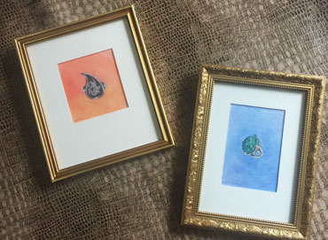 2 framed artworks in gold frames